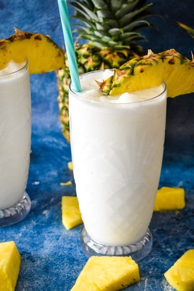 Low-carb pina coladas garnished with fresh pineapple
