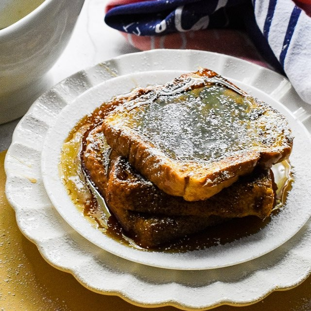 Easy French Toast topped with maple syrup and powdered sugar.